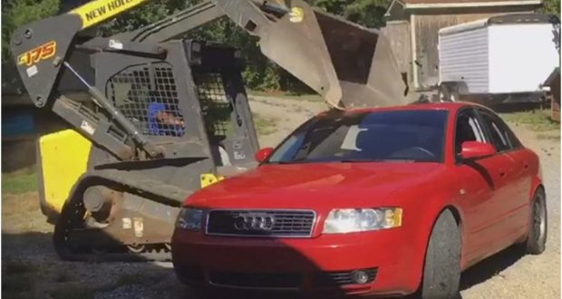 The crushed Audi and the crushing excavator