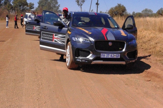 With other Motoring journalists, Femi Owoeye alighting from the F-Pace he test-drove along a rough terrain in South Africa